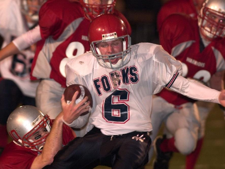 From 2001: Chenango Forks' Tim Batty gets to the open field and is dragged down by Chenango Valley's Chris Dotson in the 4th quarter Friday night at Alumni Stadium.