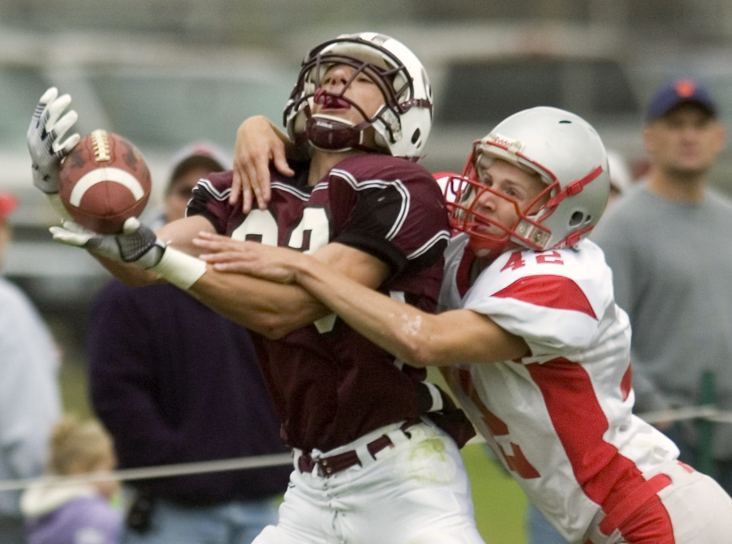 From 2009: Chenango Valley's Joe Bleil, right, tries to prevent the completion of the touchdown pass to Johnson City's Troy Robinson in the second quarter of Saturday's game at Green Field. Bleil was called for the pass interference, which was declined by JC.
