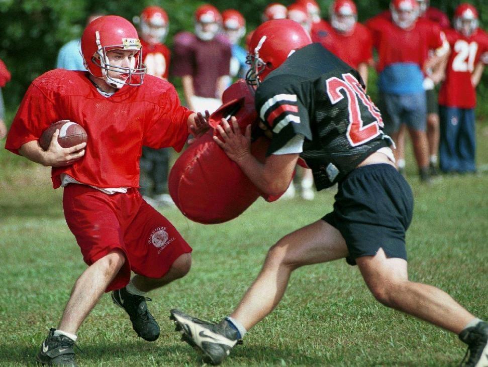 From 1998: Jarrad Maciak runs a play during football practice at Chenango Valley High School.