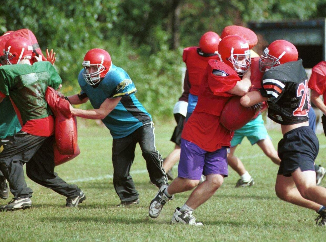 From 1998: Chenango Valley varity players run plays during a recent workout.
