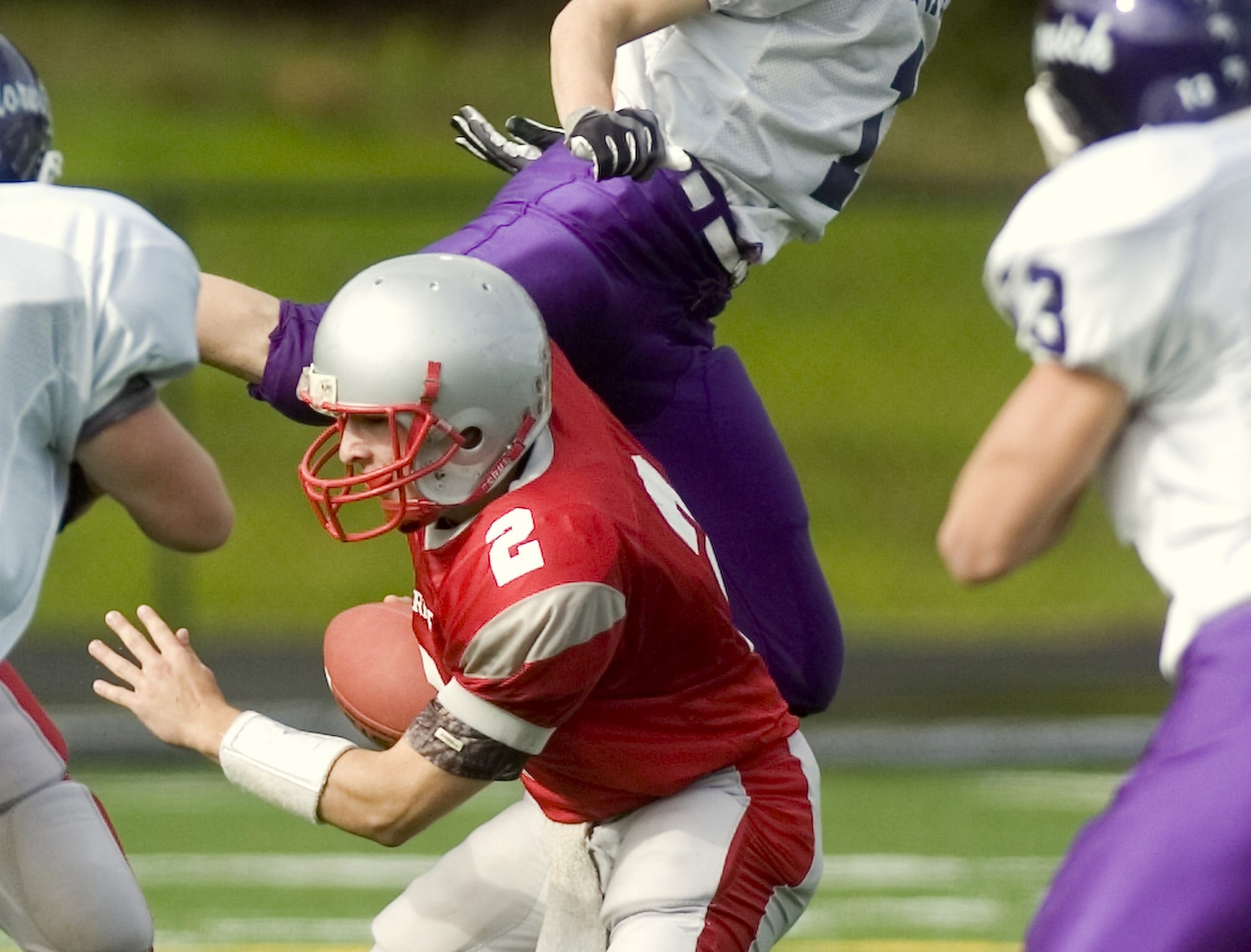 From 2009: Norwich's Casey Edwards, top, overshoots his target, Chenango Valley's Ricky Ruffo in the first quarter of Saturday's game at Greene.