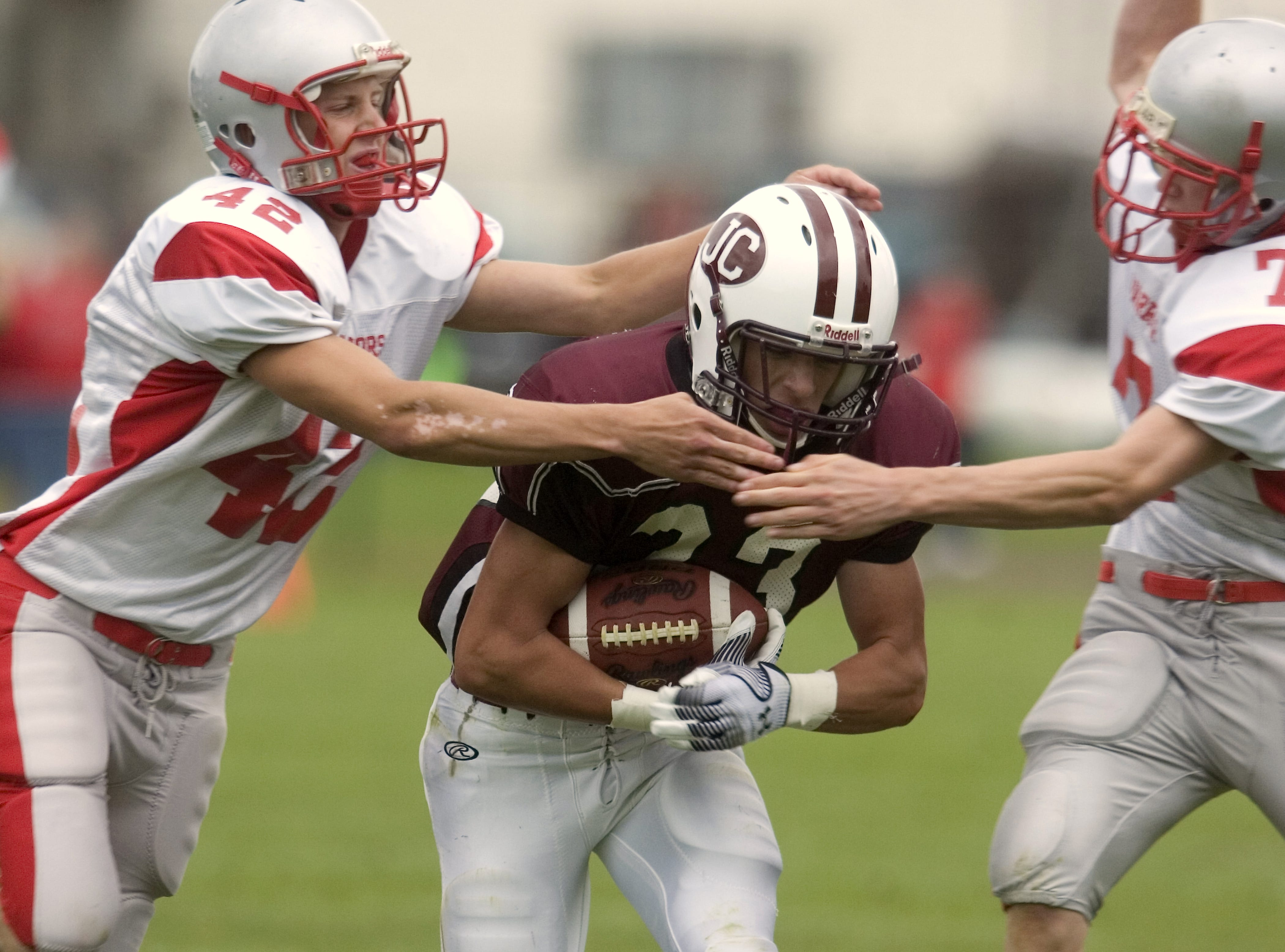 From 2009: Chenango Valley's Joe Bleil, left, and Conor Mahoney, right, team up to tackle Johnson City's Troy Robinson in the second quarter of Saturday's game at Green Field.