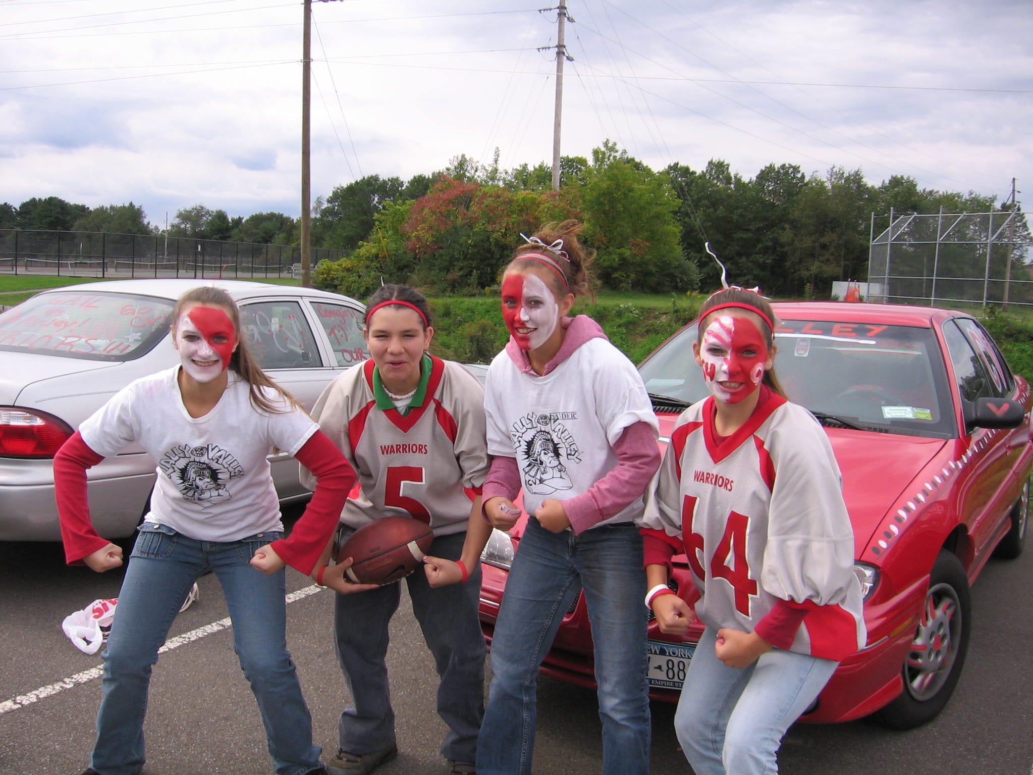 From 2018: Chenango Valley eight-graders Samantha Kline and Sanana Swan, sophomore Ashley Kline and junior Trinity Swan put on their best school spirit before the school's football game against Chenango Forks.