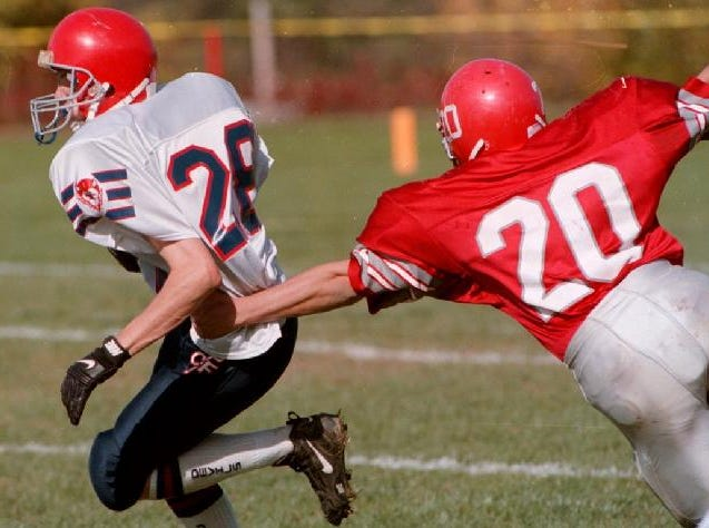 L,R, Steve Vasina of the Chenango Forks Football breaks away from Keith McKown of Chenango Valley Central during play at Chenago Valley, Saturday October 12, 1996.