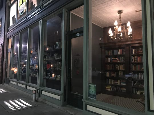 From the outset, 205 Dry appears to be a book store. Inside is a hidden bar and dining area.