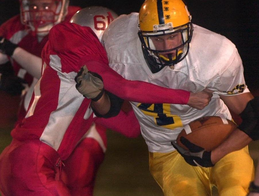 From 2001: Oneonta's James Hurtubise tries to fight off Chenango Valley's Nick Buono second quarter at Alumni field in Binghamton Friday night.
