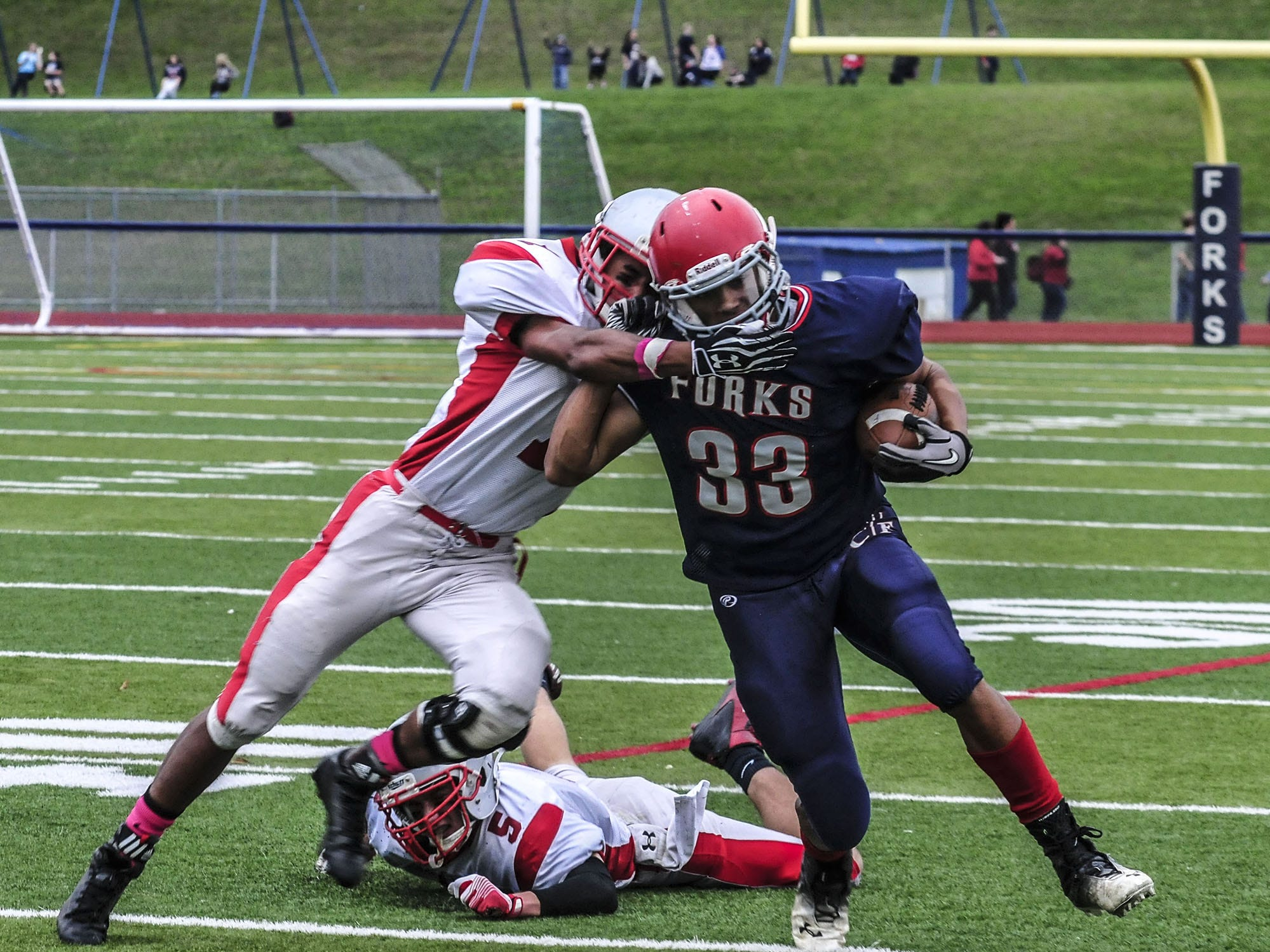 From 2013: L.J. Watson gets past Chenango Valley's Anthony Miller for a first down Saturday in Chenango Forks? 55-20 victory.