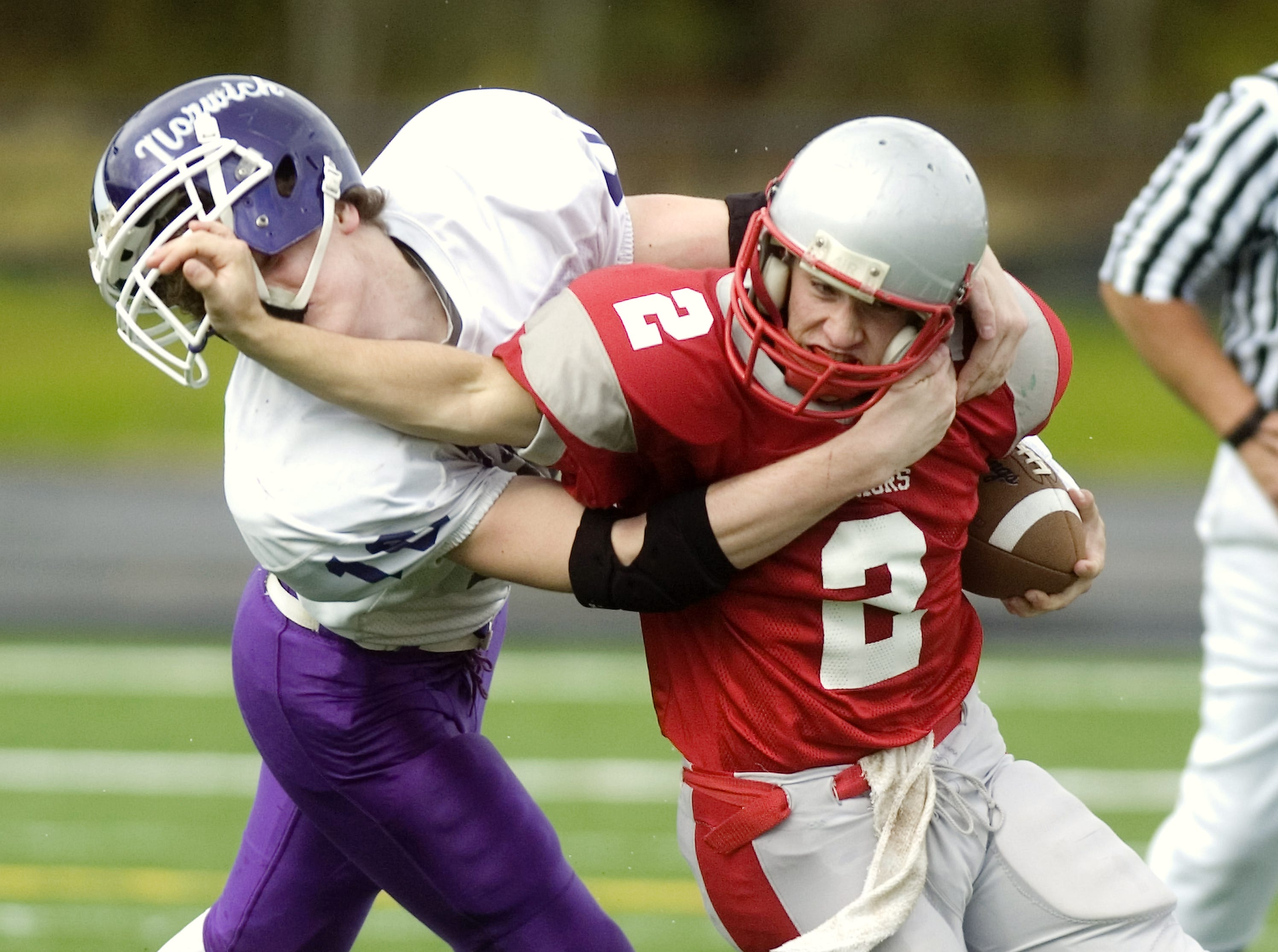 From 2009: Norwich's Morgan Cleveland, left, tries to take down Chenango Valley's Ricky Ruffo in the first quarter of Saturday's game at Greene.