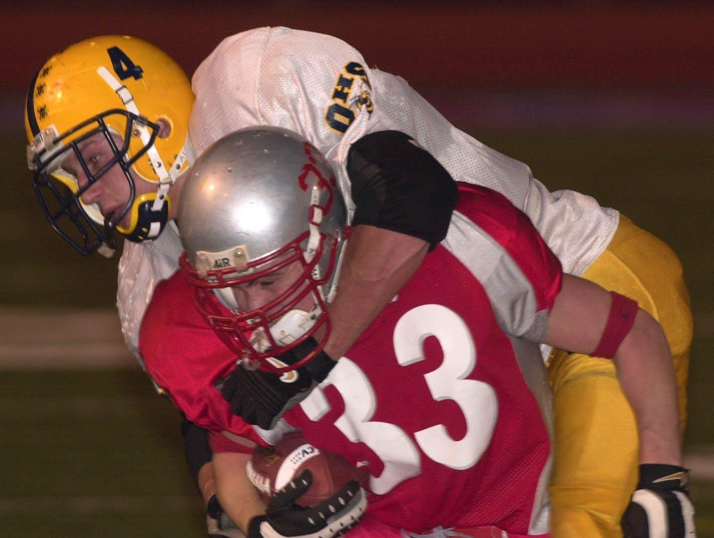 From 2001: Chenango Valley's Josh Burke is wrapped up by Oneonta's James Hurtubise in the second quarter at Alumni field in Binghamton Friday night.