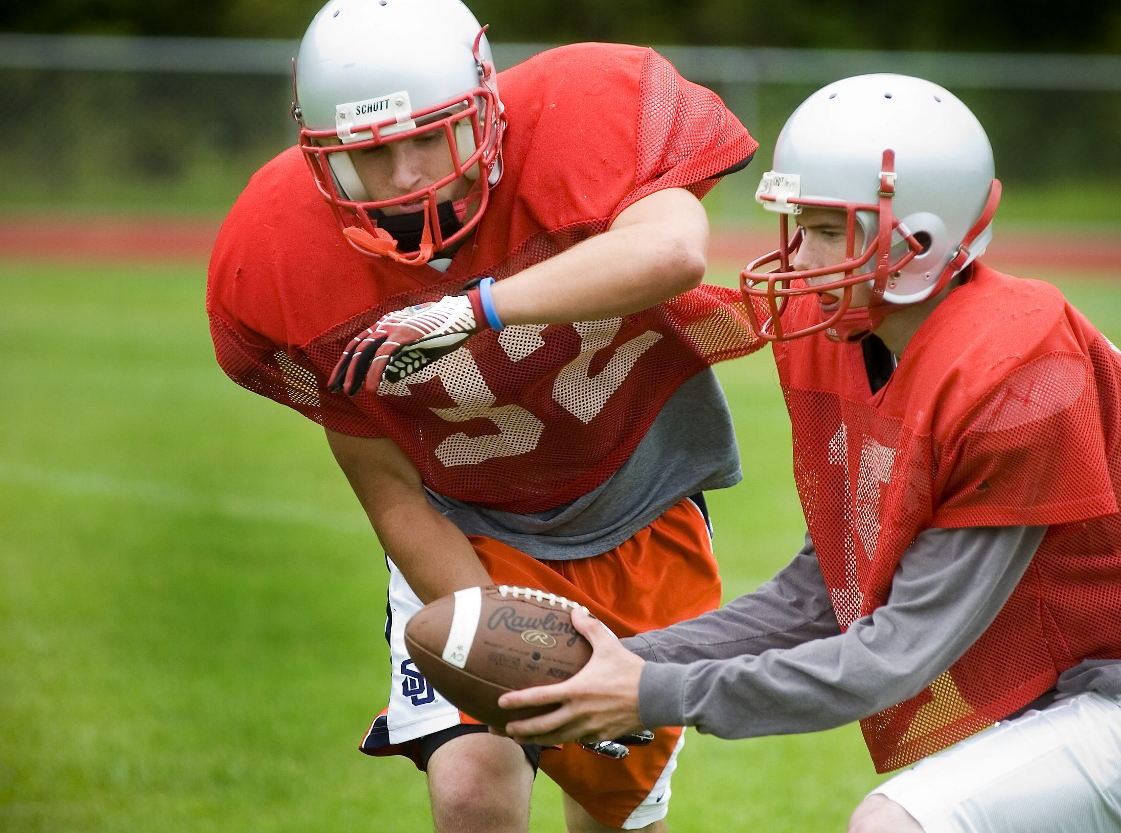 From 2007: Chenango Valley running back Trevor Cola, left, and quarterback Matt Mullins running plays during practice.