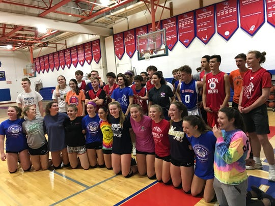 Owego's volleyball team poses for a photo with members of the Indians boys basketball team after Wednesday's practice. The volleyball team will try to win its second straight state title this weekend at Glens Falls.