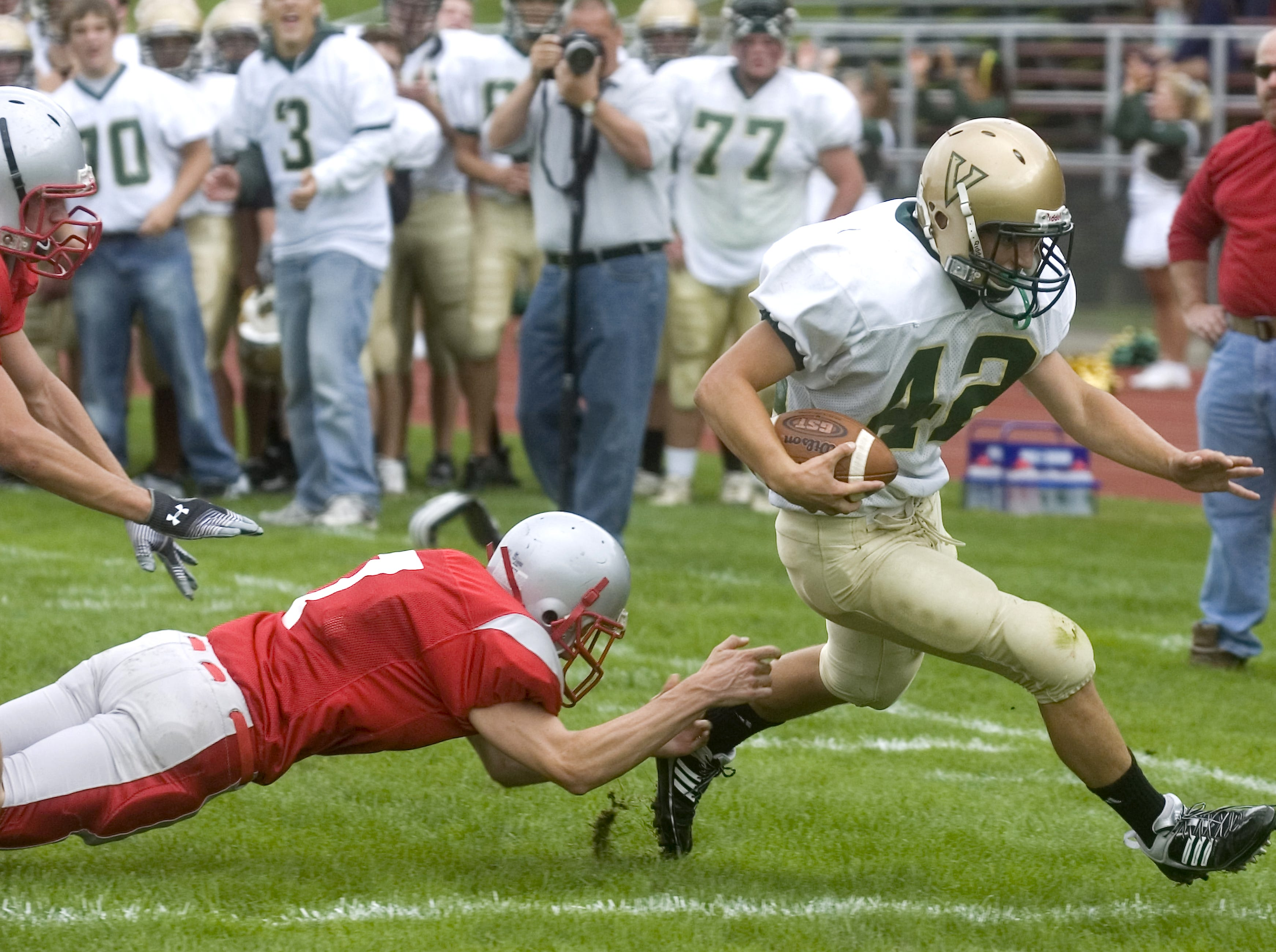 From 2009: Vestal's Thad Zaparzynski, right, dodges Chenango Valley's Conor Mahoney to reach the end zone in the second quarter of Saturday's game at CV.