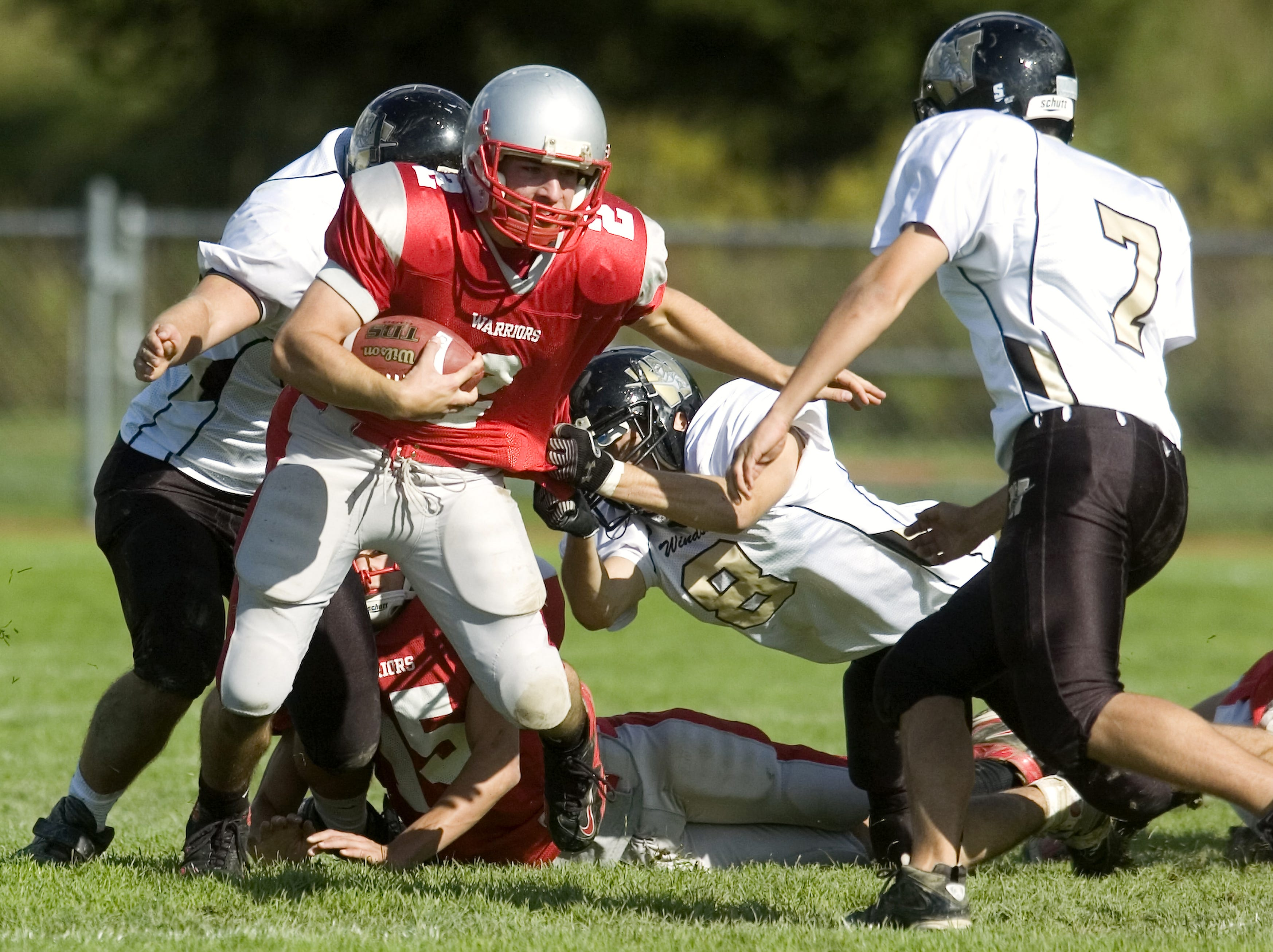 From 2009: Windsor's Danny Schreiber (8) hangs on to Chenango Valley's Ricky Ruffo's jersey as teammate Lukas VanZandt  comes in from right to defend in the fourth quarter of Saturday's game at CV.