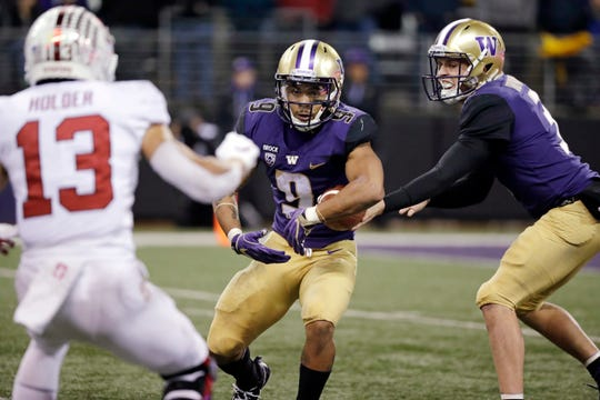 Washington running back Myles Gaskin and quarterback Jake Browning became stars under the tutelage of former offensive coordinator Jonathan Smith, now the head coach at Oregon State.