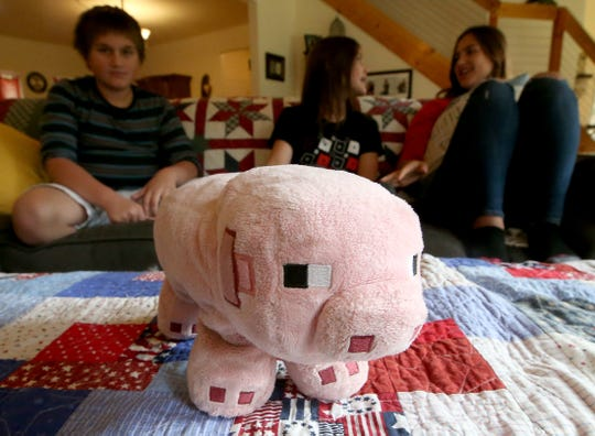 Porky the stuffed pig was the one thing that Gavin Alcover, 11, was able to grab before evacuating his home in Paradise, California, with his family.