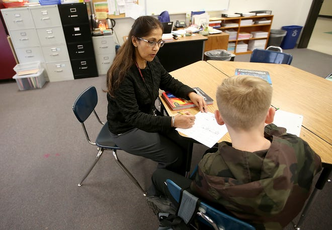 Kingston Middle School teacher Bindi Aujla helps one of her students with a math assignment during class on Thursday, November 15, 2018.