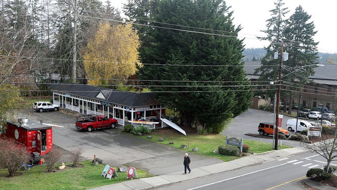 An investment group is proposing to redevelop three parcels just north of Bainbridge Island City Hall on Madison Avenue to build a mixed-use complex with rental units, an inn and commercial office space. As part of the project, the group is proposing to create underground parking by digging out polluted dirt on the property.