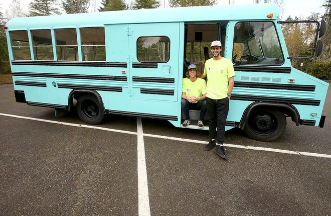 Hans and Nick Schippers with the bus they are renovating to travel down the coast in while teaching students about the ways they can reduce their use of plastics and live more sustainable lives. In partnership with Sustainable Coastlines Hawaii, the brothers hope to reach 10,000 students during the trip.
