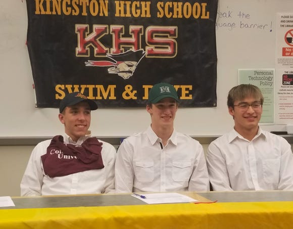 Kingston swimmings Ethan Fox (from left), Tim Gallagher and Aron Markow signed national letters of intent on Nov. 14, 2018 during a ceremony at the high school.