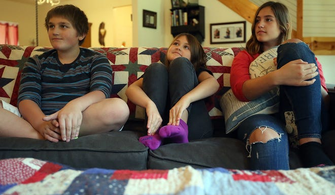 From left, Gavin, Phoenix and Kylie Alcover talk about evacuating from their home in Paradise, California. The Alcover children are staying with family friends in Suquamish while their parents try to salvage what they can back home.
