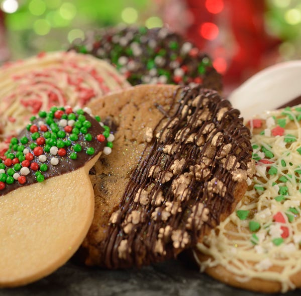 Guests at the Epcot International Festival of the Holidays can enjoy a Cookie Stroll through the park.