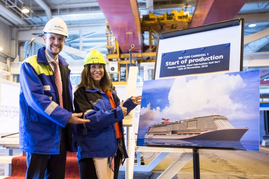 "Jan Meyer, chief executive officer of the Meyer Turku shipyard, and Carnival Cruise Line President Christine Duffy were on hand for the start of construction of carnival's new ""XL-class"" ship at the shipyard in Finland."