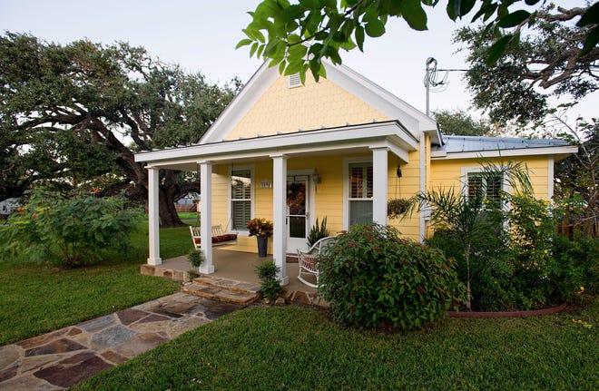 The Broach family's Old Rockport 1905 vintage cottage sits on a huge oak tree covered lushly landscaped lot.