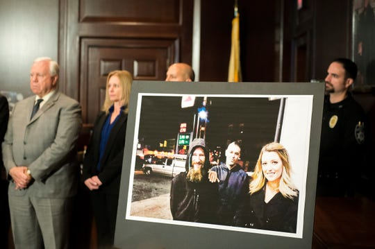 An image of Johnny Bobbitt Jr., from left, Mark D'Amico and Katelyn McClure on display during a press conference Thursday, Nov. 15, 2018 in Mount Holly, N.J. The three are charged in a conspiracy to defraud GoFundMe contributors.