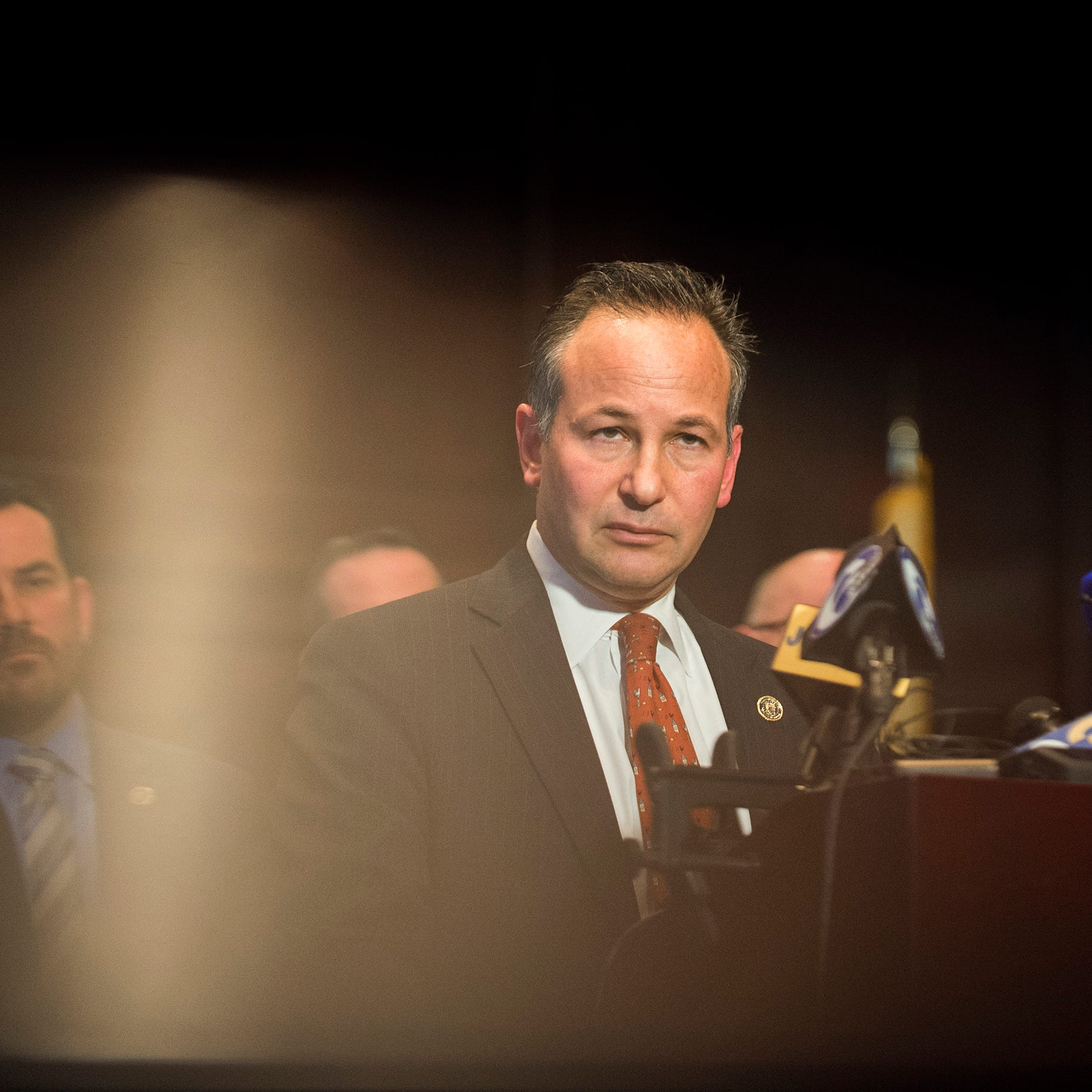 Burlington County Prosecutor Scott Coffina addresses media during a press conference regarding the three individuals charged in a conspiracy to defraud GoFundMe contributors Thursday, Nov. 15, 2018 in Mount Holly, N.J.