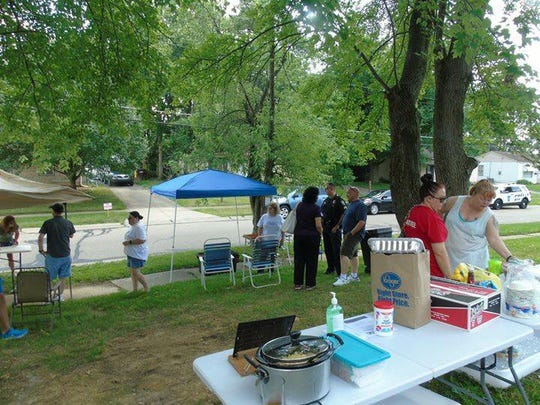 Pocket picnics such as this one on Hyannis Drive were conducted in different parts of Northbrook to give people a chance to meet their neighbors.