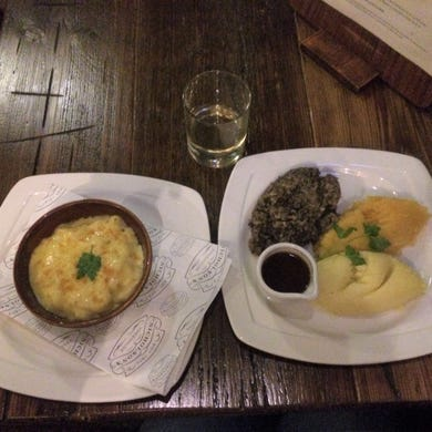 My very first meal in Scotland (besides airport food): haggis, neeps and tatties with macaroni and cheese on the side and a glass of Talisker whiskey at The Last Drop in Edinburgh. There I discovered that haggis is actually delicious, and I like the fiery taste of Scotch Whiskey. This historic pub is where prisoners downed their last drink before being hanged in Grassmarket, just outside the doors.