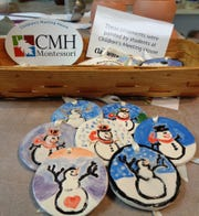 Special glazed snowman ornaments painted by students at CMH Montessori School in Loveland will be sold during Christmas in Loveland to benefit the school.