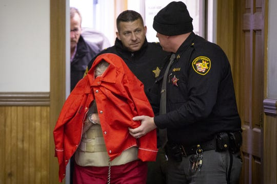 """Fredericka Wagner, 76, of Lucasville, covers her face as she walks into the Pike County Courthouse for her arraignment Thursday, November 15, 2018.  Wagner along with Rita Newcomb, 65, of South Webster,  are accused of perjury and obstructing justice for allegedly misleading investigators; Newcomb also is charged with forging custody documents to cover up the crimes. The women are mothers of Angela Wagner and George """"Billy"""" Wagner and grandmothers of the Wagners' two sons, George Wagner IV and Edward """"Jake"""" Wagner, who are facing murder charges.  The killings took place in 2016  at different scenes, all around the same time with 32 bullets fired into the eight victims. It would spawn the largest homicide investigation in Ohio history."""