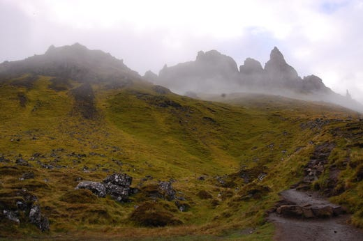 On my first evening on the Isle of Skye, I hiked through the mist and clouds to Old Man of Storr, a prominent rock formation that sits by the cliff-lined coastline of the island.