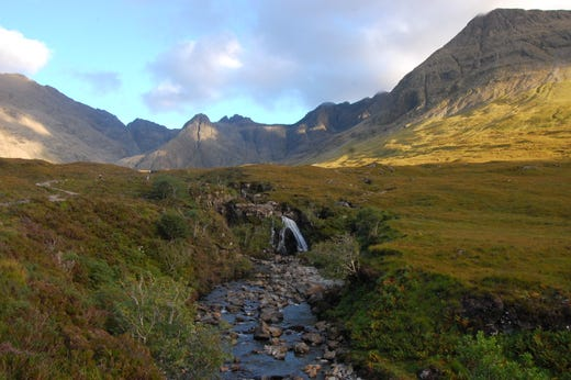 At the foot of the Black Cuillins on the Isle of Skye trickles a stream with hundreds of little waterfalls. All that's missing is the country's national animal - the unicorn (yes, really).