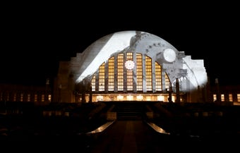 Cincinnati Museum Center celebrated the restoration of the historic train station with 15-minute videos projected onto the front of the terminal.