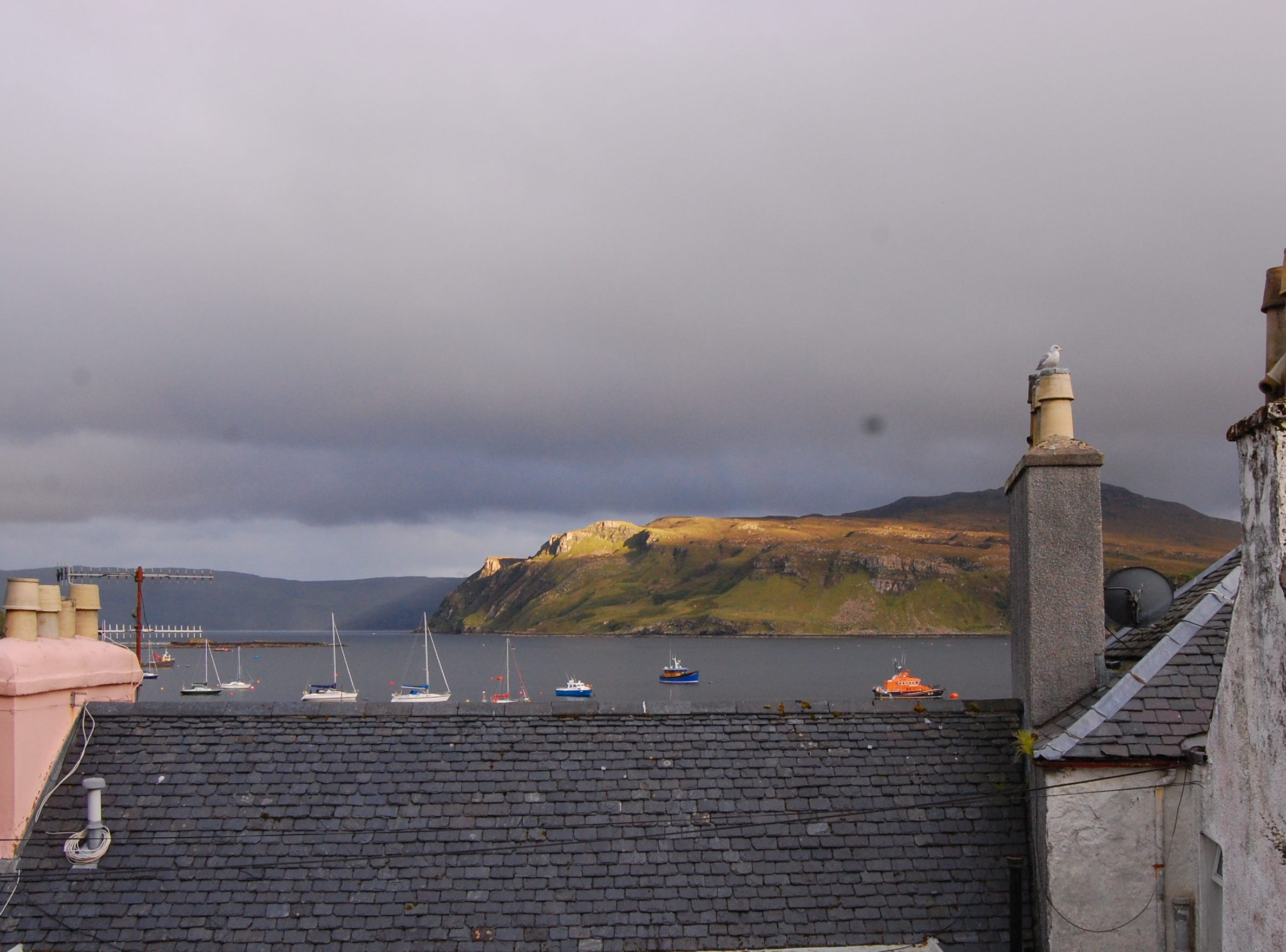 The tiny town of Portree boasts beautiful views, cozy eateries and pubs, where I spent my evenings reviving myself with plates of fish and chips and haggis after long days of hiking.