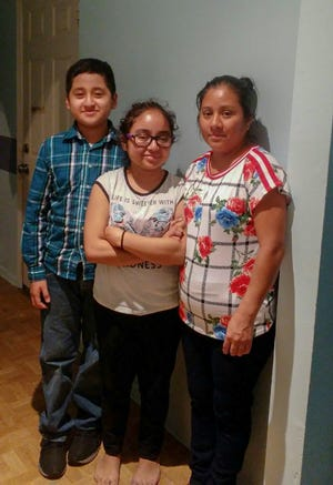 Óseas, Heather and their mother, Natalia Garcia. Natalia Garcia would love nothing more than to give her two daughters two twin beds for their bedroom.