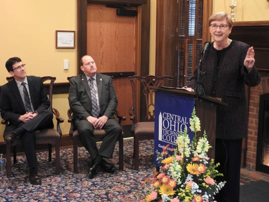 David Brillhart, vice president for Business Affairs at Central Ohio Technical College, and Bob Pell, executive director of the Coshocton Foundation, listen to Bonnie Coe, COTC president, speak on the new Coshocton Promise tuition-free program. The initiative, starting with the summer semester, will make up the gap between grants and other financial aid with tuition at the institution for those with a household income of $60,000 a year or less. The Clarence and Grace Miller Scholarship endowment at the Coshocton Foundation is helping with the Promise program.