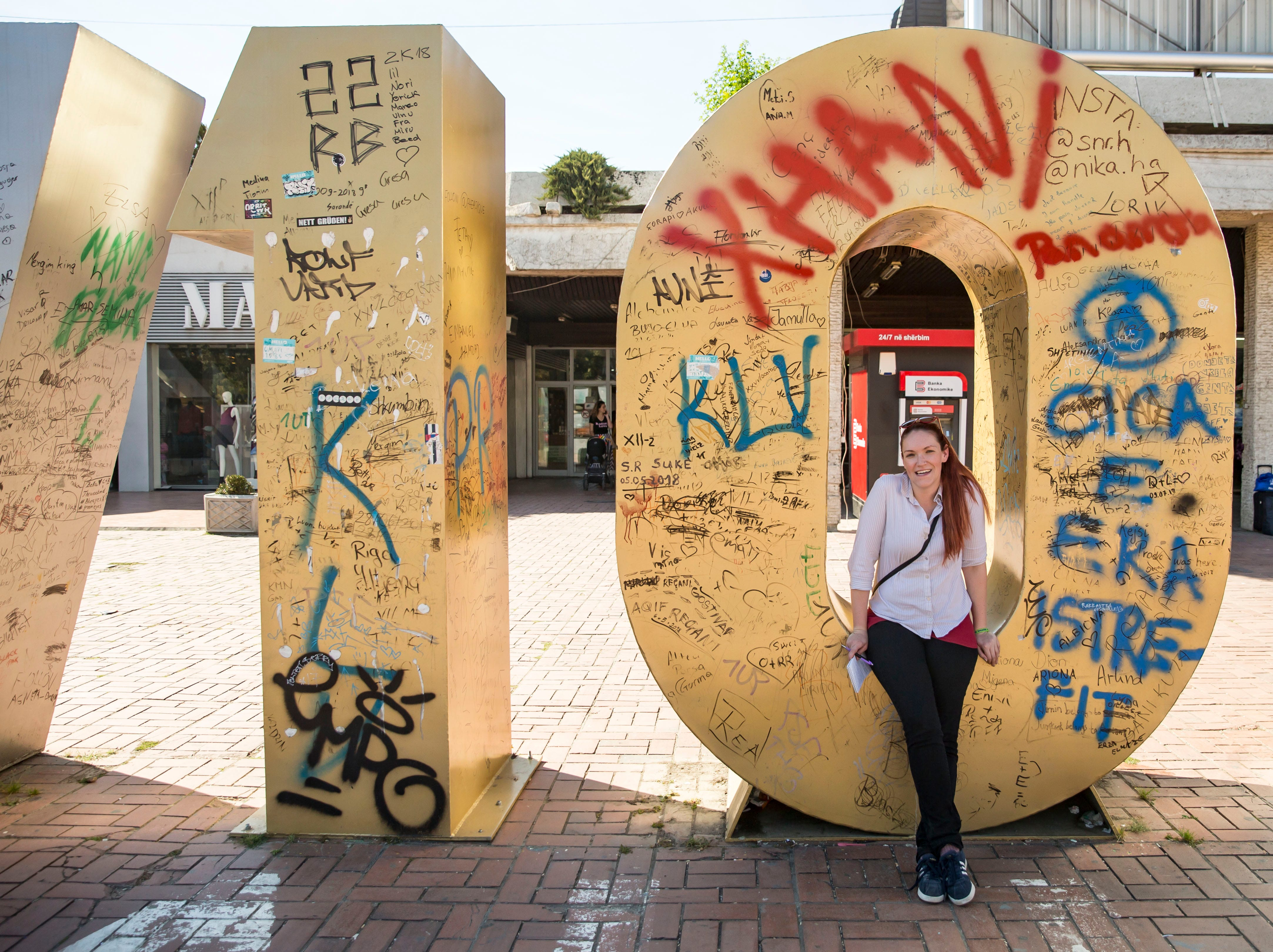 Iowa columnist Courtney Crowder at the Newborn sculpture in Pristina, Kosovo, Monday Sept. 17, 2018. This year, the O and R have been replaced with a 1 and 0 to commemorate the 10th anniversary of Kosovo's independence.