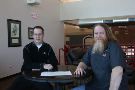 Jeff Heng, left, and Shawn McNeeley, owners of Mistress Brewing Company in Ankeny, Iowa.
