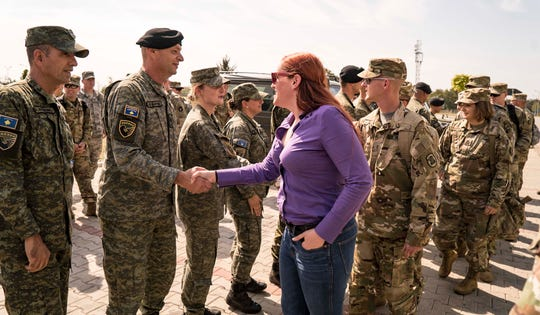 Iowa Columnist Courtney Crowder greets members of the Kosovo Security Force at their base near Pristina in Sept. 2018, during a visit with the Iowa National Guard.
