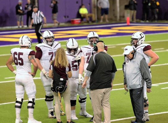 Jim Williams, wearing the white hat, walks toward the sideline inside the UNI-Dome on Nov. 9, 2018. The Maroons beat Bettendorf, 41-34, in the Class 4A state semifinals that night.