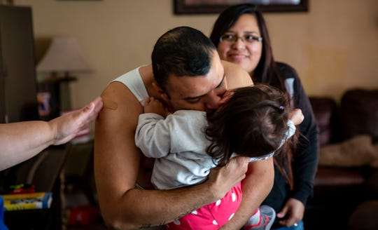 Jairo Morales Landaverde, 25, plays with his niece Natalie during lunch at their Des Moines home, Oct. 26, 2018. Over six years ago, Jairo was a victim of a gang attack at the family's first home, leaving him bloodied on the kitchen floor after he was beat by a crow bar.