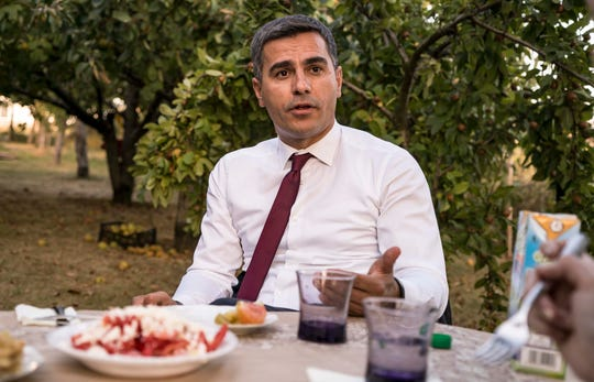 Vushtrri Mayor Xhafer Tahiri speaks to us at his family's orchard over a meal in Kosovo in Sept. 2018.