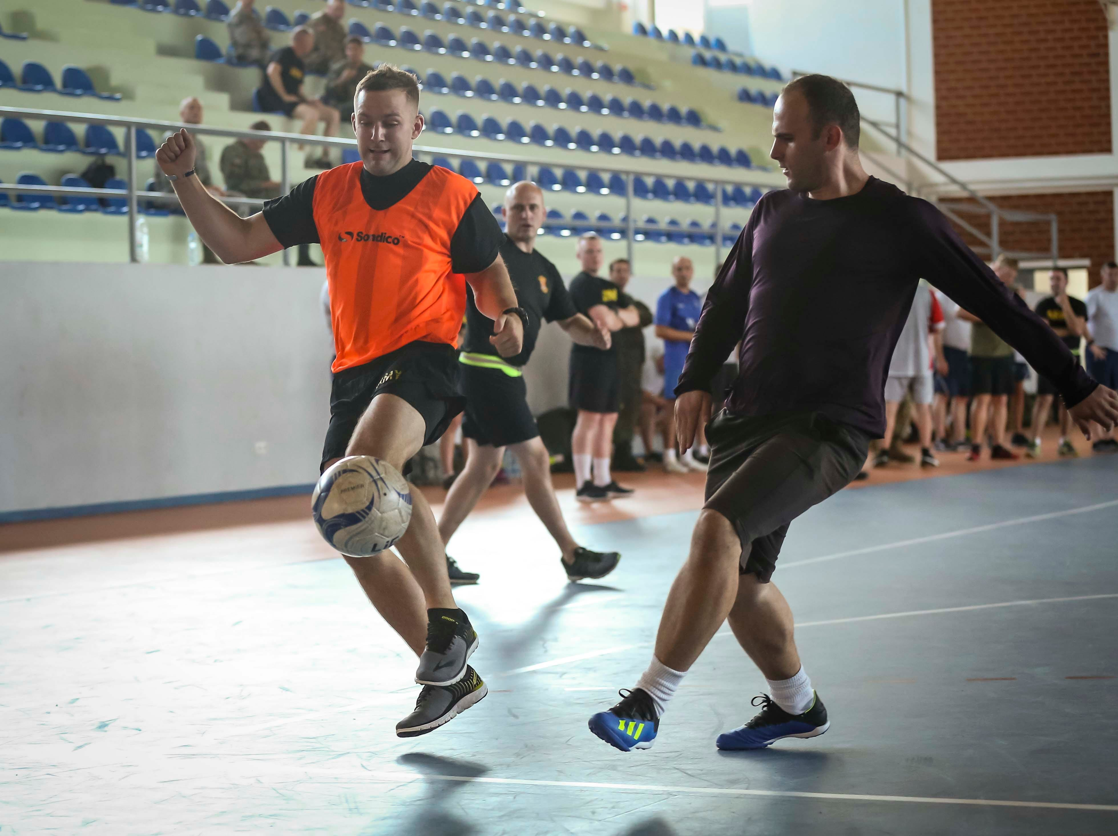 Members of the Iowa National Guard play indoor soccer with members of the Kosovo Security Force at their base near Pristina, Kosovo in Sept. 2018.
