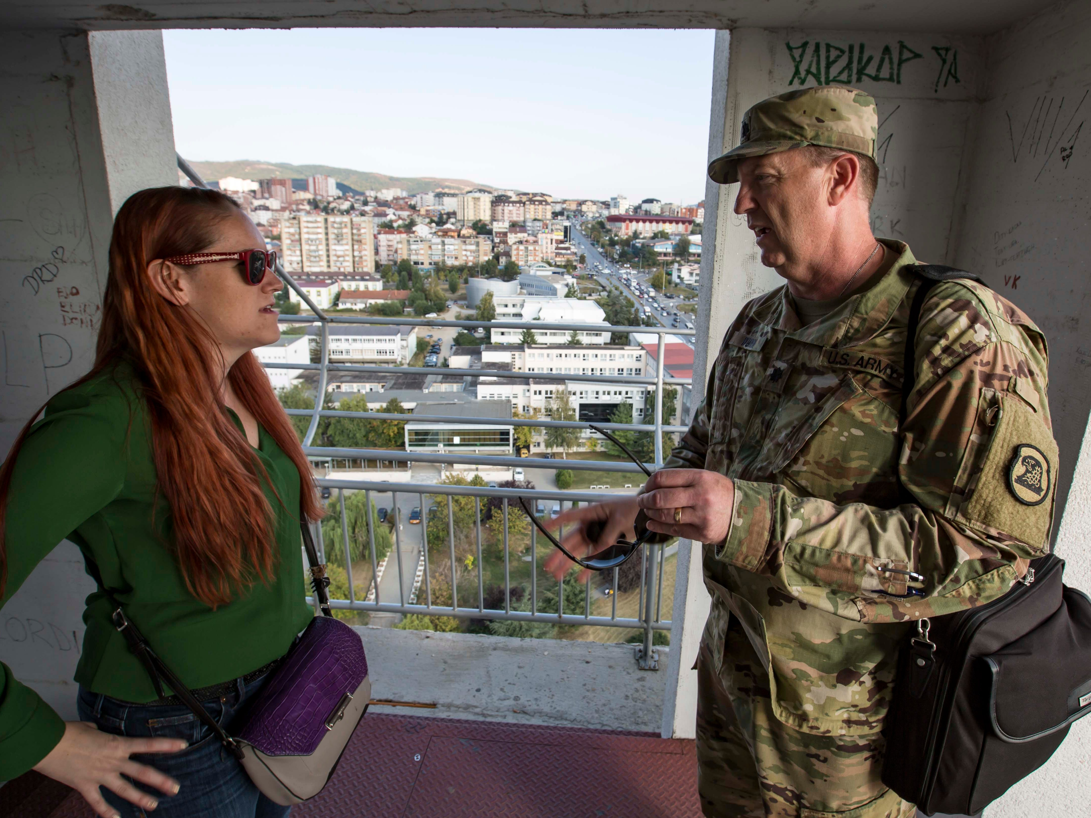 Iowa Columnist Courtney Crowder speaks with Lt. Col. Michael Wunn in the bell tower of the Cathedral of Saint Mother Teresa in Sept. 2018, in Kosovo.