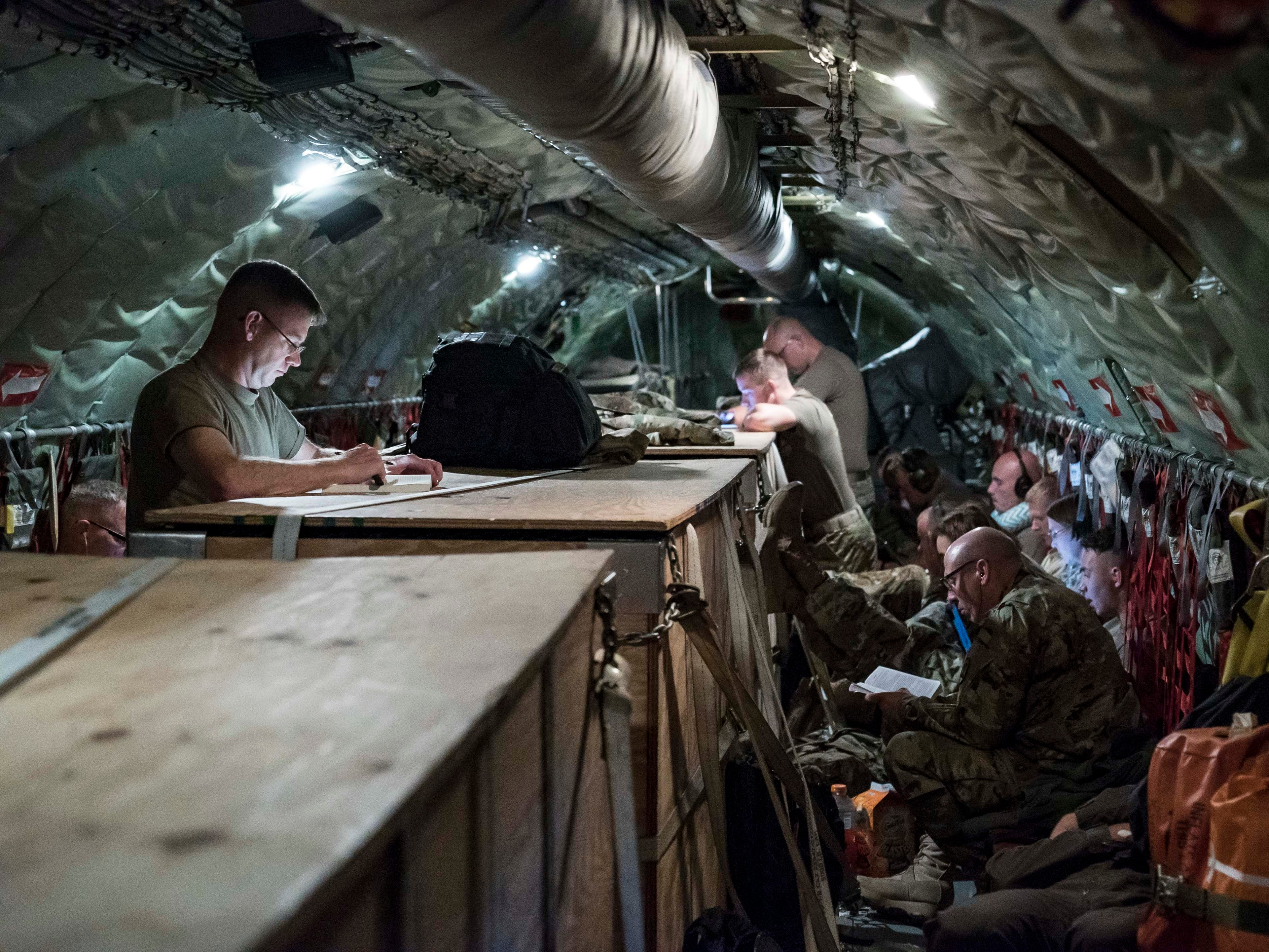 Iowa National Guardsmen read, watch videos or slept during the flight to Kosovo, Sept. 16, 2018, in a KC-135E Stratotanker on the 10-hour direct trip.