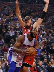 Detroit Pistons center Andre Drummond (0) tries to get around Toronto Raptors center Jonas Valanciunas (17) during the first quarter at Scotiabank Arena on Wednesday, Nov. 14, 2018.