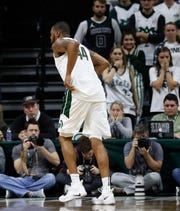 Michigan State forward Nick Ward (44) hobbles off the court during the first half of the team's game against Louisiana-Monroe on Nov. 14 in East Lansing, Mich. Ward went down midway through the first half and pounded the court with both fists. The forward got up and hobbled off the court, trying to keep weight off his right leg.